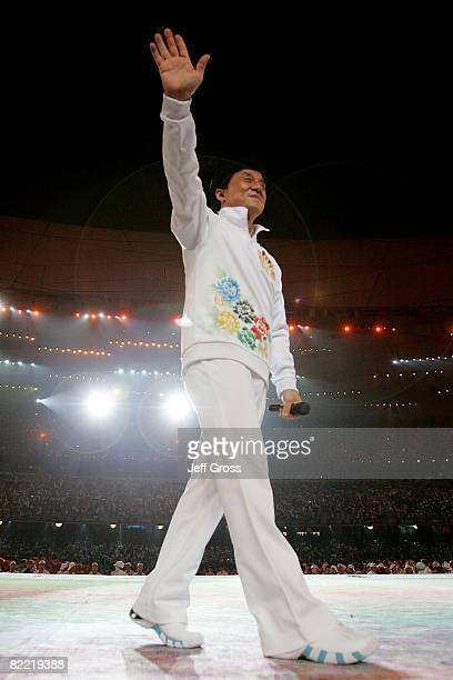 Hong Kong actor Jackie Chan waves to the crowd during the Opening Ceremony for the 2008 Beijing Summer Olympics at the National Stadium on August 8...