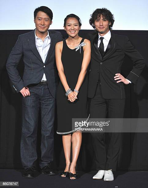 Hong Kong actor Leon Lai Chinese actress Zhang Ziyi and Japanese actor Masanobu Ando pose for photographers before the premiere of their movie...