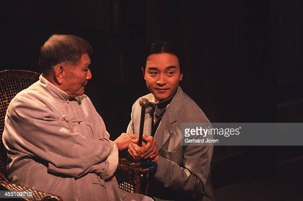 Hong Kong actor Leslie Cheung Kwok Wing with Chinese actor Xie Tian during the filming of 'Temptress Moon' in Shanghai Film Studios