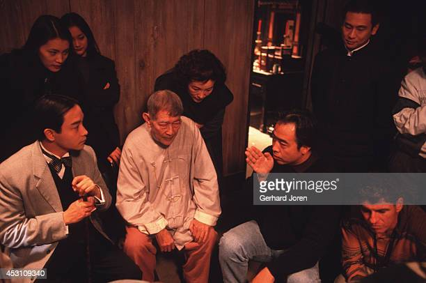 Hong Kong actor Leslie Cheung Kwok Wing with Chinese actor Xie Tian director Chen Kaige and cinema photographer Chris Doyle during the filming of...