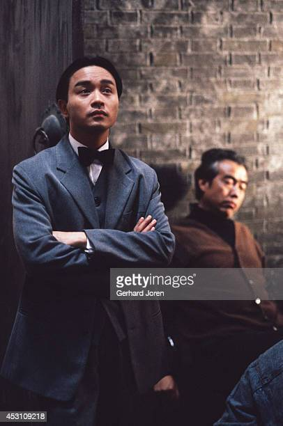 Hong Kong actor Leslie Cheung Kwok Wing with Chinese director Chen Kaige during the filming of 'Temptress Moon' in Shanghai Film Studios