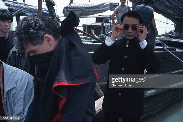 Hong Kong actor Leslie Cheung Kwok Wing with cinema photographer Chris Doyle during the filming of 'Temptress Moon'