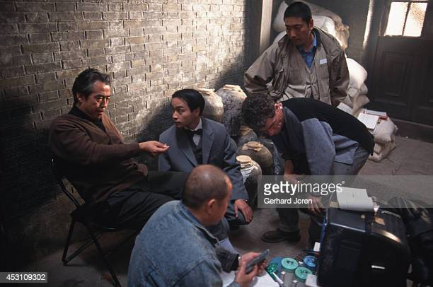 Hong Kong actor Leslie Cheung Kwok Wing with director Chen Kaige and cinema photographer Chris Doyle during the filming of 'Temptress Moon' in...
