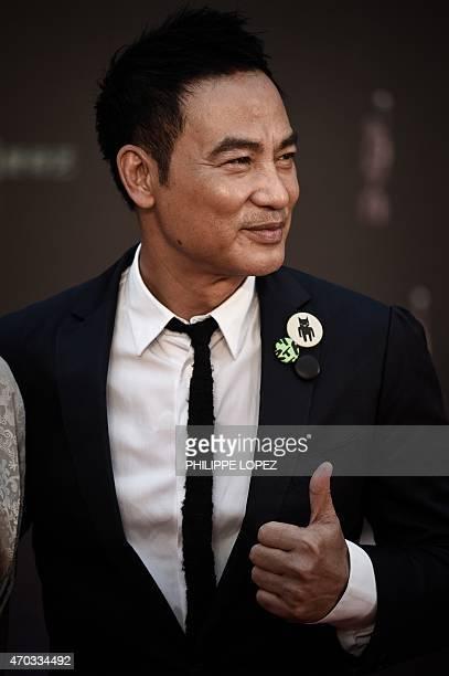 Hong Kong actor Simon Yam poses on the red carpet at the 34rd Hong Kong Film Awards in Hong Kong on April 19 2015 The annual awards are the Hong Kong...