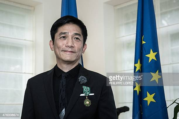 Hong Kong actor Tony Leung poses after receiving the distinction of Officier de lOrdre des Arts et des Lettres at the French Residence in Hong Kong...