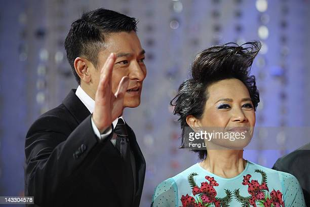 Hong Kong actors Andy Lau and Deanie Ip arrive for the red carpet of 2nd Beijing International Film Festival at China National Convention Center on...
