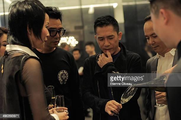Hong Kong actress Cecilia Lee, Hong Kong musician Kenny Bee, Hong Kong international actor Tony Leung and Chinese chairman of Yintai Shen Guo Jun are...