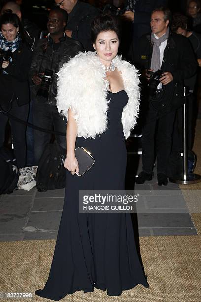 Hong Kong actress Cherie Chung poses on October 8 2013 as she arrives at the Beaux Arts school in Paris to attend a dinner organized by US fashion...