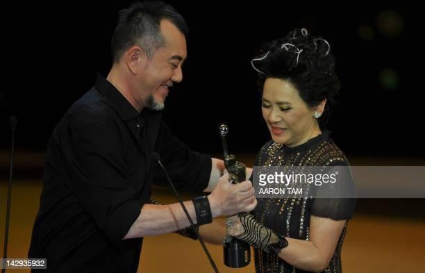 Hong Kong actress Deanie Ip is presented the Best Actress award by Hong Kong actor Anthony Wong at the 31st Hong Kong Film Awards on April 15 2012...