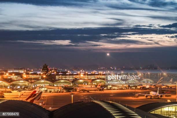 hong kong airport during the evening - hong kong international airport stock photos and pictures