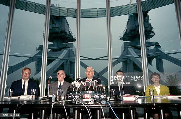 Hong Kong and Shangai Banking Corp Group Chairman Sir William Purves and John Gray chairman of the Hong Kong Bank address reporters declaring on...