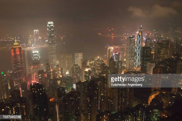 hong kong at night, dramatic view - argenberg stock pictures, royalty-free photos & images