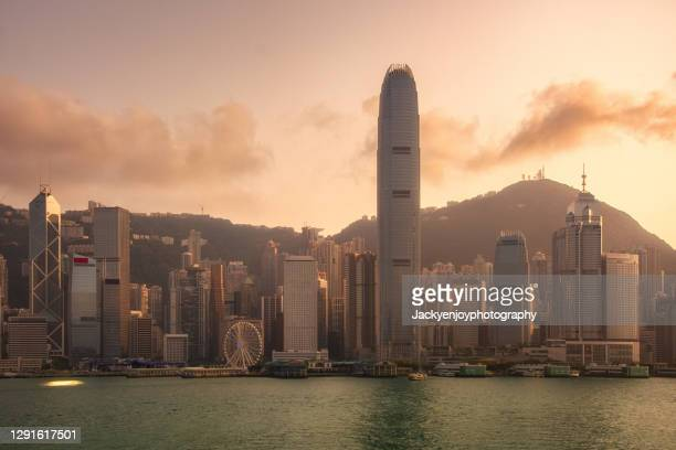hong kong at victoria harbour, skyline - kowloon peninsula stock pictures, royalty-free photos & images