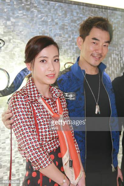 Hong Kong billionaire Joseph Lau Luen Hung's wife Chan Hoiwan singer and actor Richie Jen Hsienchi attend the opening ceremony of a sport brand's...