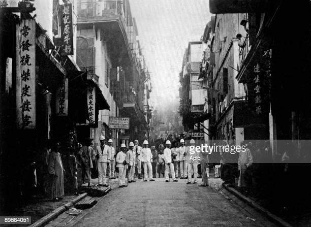 Hong Kong c 1890 plague inspectors in a street of the town