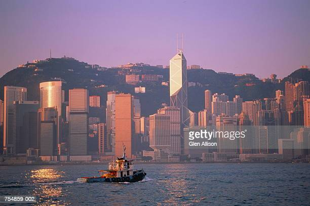 Hong Kong, Central, city skyline and harbour at dusk