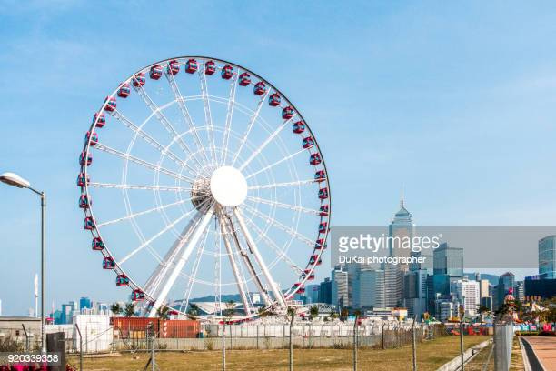 hong kong central ferris wheel. - ferris wheel stock pictures, royalty-free photos & images