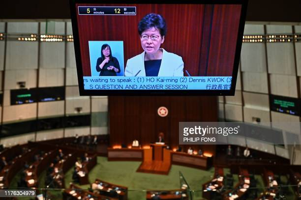 Hong Kong Chief Executive Carrie Lam is pictured on an internal broadcast as she holds a question and answer session at the Legislative Council in...