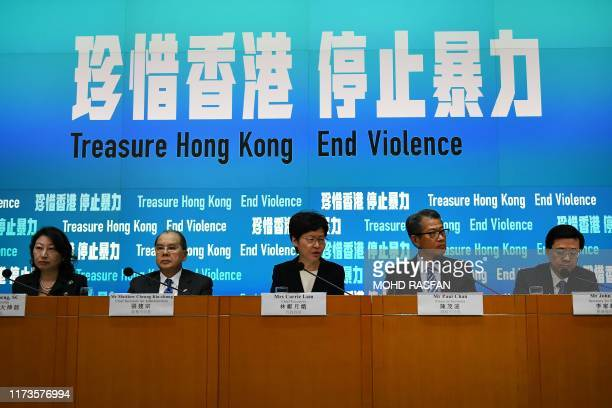 Hong Kong Chief Executive Carrie Lam speaks as she sits with members of her cabinet during a press conference in Hong Kong on October 4, 2019. - Hong...
