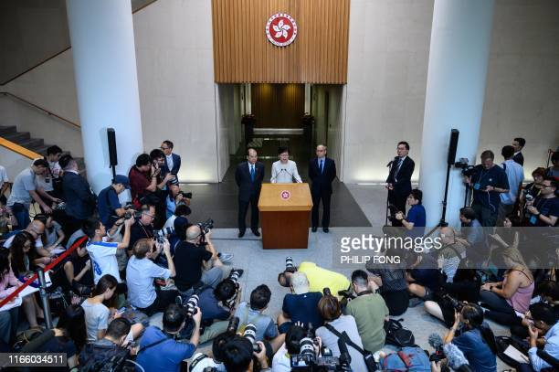 TOPSHOT Hong Kong Chief Executive Carrie Lam speaks at a press conference with Chief Secretary for Administration Matthew Cheung and Secretary for...