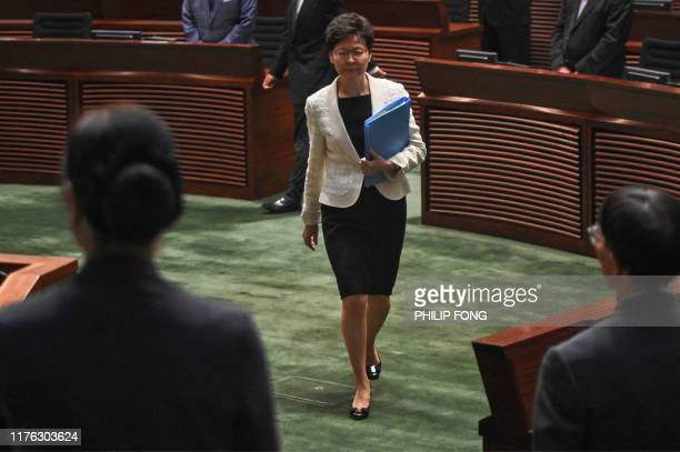 Hong Kong Chief Executive Carrie Lam walks inside the chamber as she attends a question and answer session at the Legislative Council in Hong Kong on...