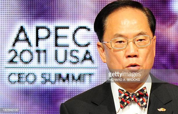 Hong Kong Chief Executive Donald Tsang speaks at the APEC CEO Summit 2001 meeting, part of the Asia-Pacific Economic Cooperation summit in Honolulu,...