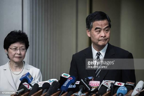 Hong Kong Chief Executive Leung Chunying addresses a press conference next to Chief Secretary Carrie Lam in Hong Kong on April 22 2015 Hong Kong's...
