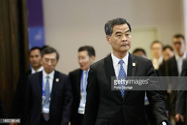 Hong Kong Chief Executive Leung Chunying arrives at the APEC Summit venue on October 6 2013 in Nusa Dua Indonesia