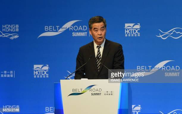 Hong Kong Chief Executive Leung Chunying gives the opening remarks of the Belt and Road summit being held in Hong Kong on May 18 2016 Protesters...