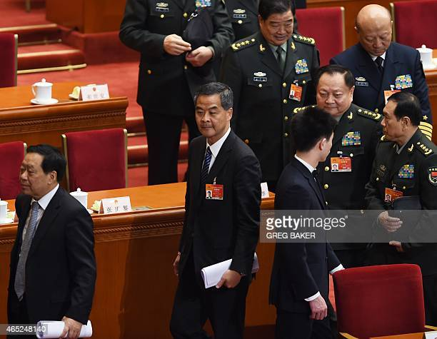 Hong Kong Chief Executive Leung Chunying walks out after the opening session of the National People's Congress at the Great Hall of the People in...