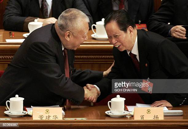 Hong Kong chief executive Tung Chee-hwa greets Xiao yang , president of China's Supreme People's Court ahead of the opening session of the Chinese...