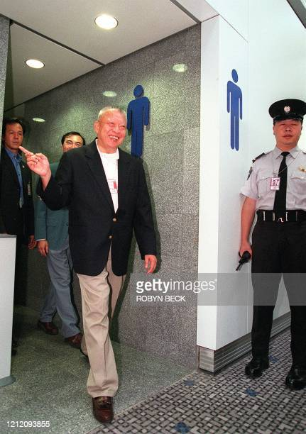 Hong Kong Chief Executive Tung Cheehwa leaves a washroom at the new Chek Lap Kok airport after inspecting it during his first visit to the airport...