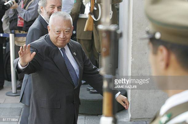 Hong Kong Chief Executive Tung CheeHwa waves as he enters at La Moneda Presidential Palace to attend the opening of the APEC leaders' 2nd retreat AFP...
