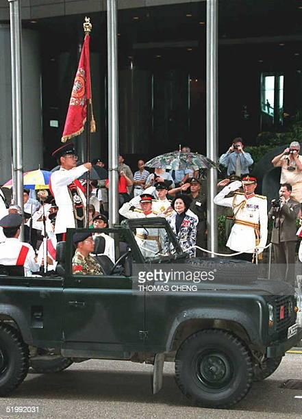 Hong Kong Chief Secretary Anson Chan and General Michael Rose review the Royal Hong Kong Regiment officers during the disbandment parade 02 September...