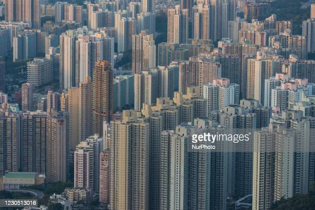 Hong Kong, China, 9 Jan 2021, Rows of buildings in Kowloon in the early morning. Hong Kong saw for the first time of the year negative temperatures...