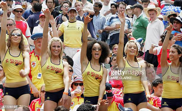 A group of female spectators dance in Hong Kong Stadium during action at the Hong Kong Rugby Sevens tournament 01 April 2006 The annual tournament...