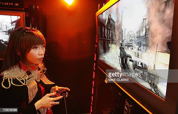 Young girl plays computer games at the Asia Game Show in Hong Kong, 15 December 2006. The game and digital entertainment products exhibition will...