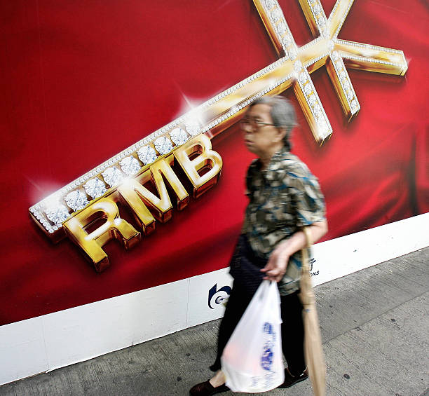 An Elderly Woman Walks Past A Sign For T Pictures Getty Images