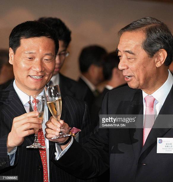 Bank of China chairman, Xiao Gang , and Ronald Arculli, chairman of the board of Hong Kong Exchanges and Clearing toast during the listing of the...