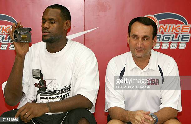 Coach of the USA team headed to the World Basketball Championships in Japan later this month Mike Krzyzewski smiles as star player LeBron James of...
