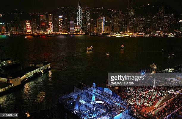 CORRECTION People celebrate bringing in the New Year holiday at the a music party at the landmark Victoria Harbour front in the Tsim Sha Tsui...