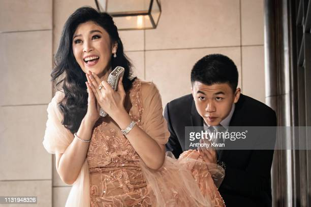 Hong Kong CHINA Former Thai Prime Minister Yingluck Shinawatra greets members of media as she arrives for the wedding of former Thai prime minister...