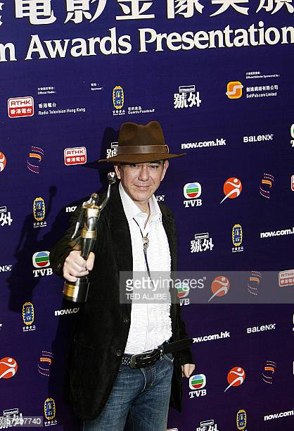 Hong Kong actor Anthony Wong poses with his trophy after winning the Best Supporting Actor at the 25th Hong Kong Film Awards in Hong Kong 08 April...