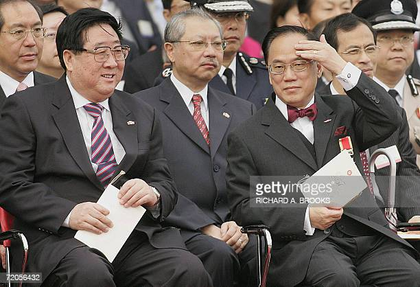 Hong Kong Chief Executive Donald Tsang gestures while pictured with Hong Kong's Secretary for Housing Planning and Lands Michael Suen and Gao Siren...