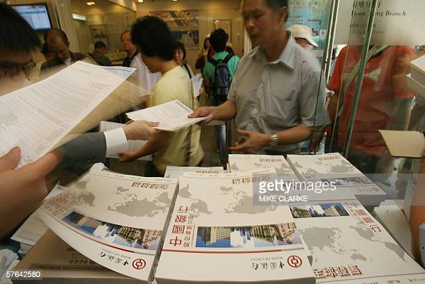 Hundreds make a grab for prospectuses for the Bank Of China's eagerlyawaited Initial Public Offering at a local bank in Hong Kong 18 May 2006...