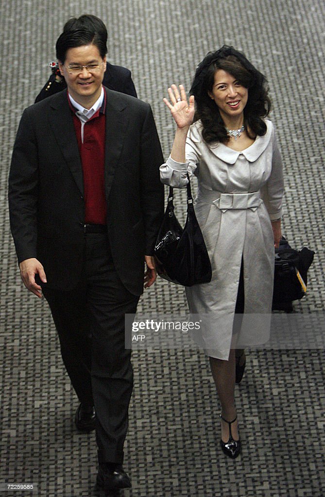 Oasis Hong Kong Airlines Chairman Raymond Lee And His Wife Executive Director Priscilla Lee Walk After