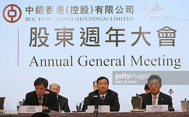 Sun Changji Vice Chaiman Bank of China Hong Kong Limited Xiao Gang Chairman and He Guangbei Vice Chairman and Chief Executive attend a press...