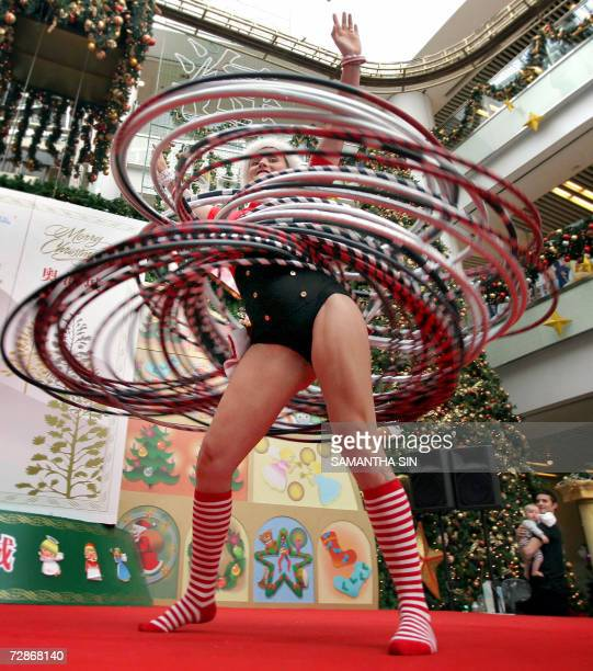 The Guinness World Record Champion of Hula Hoops Kareena Oates from Australia performs her hulahoops skills at a local shopping mall in Hong Kong 22...