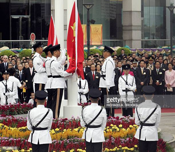 The Hong Kong and Chinese flags are about to be raised during an official ceremony outside the Hong Kong Convention and Exhibition Centre 01 October...