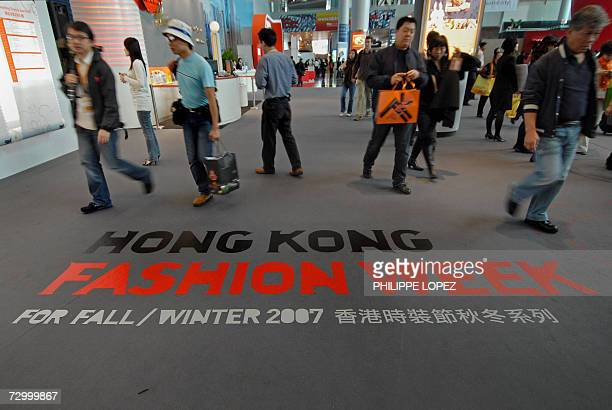 Visitors walk over a logo of the Hong Kong fashion week for fall/winter 2007 at the Convention and Exhibition center in Hong Kong 15 January 2007 The...